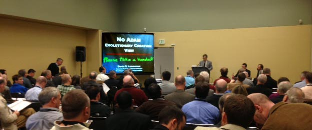 "Photo of Denis O. Lamoureux presenting the ""no Adam"" view at ETS"